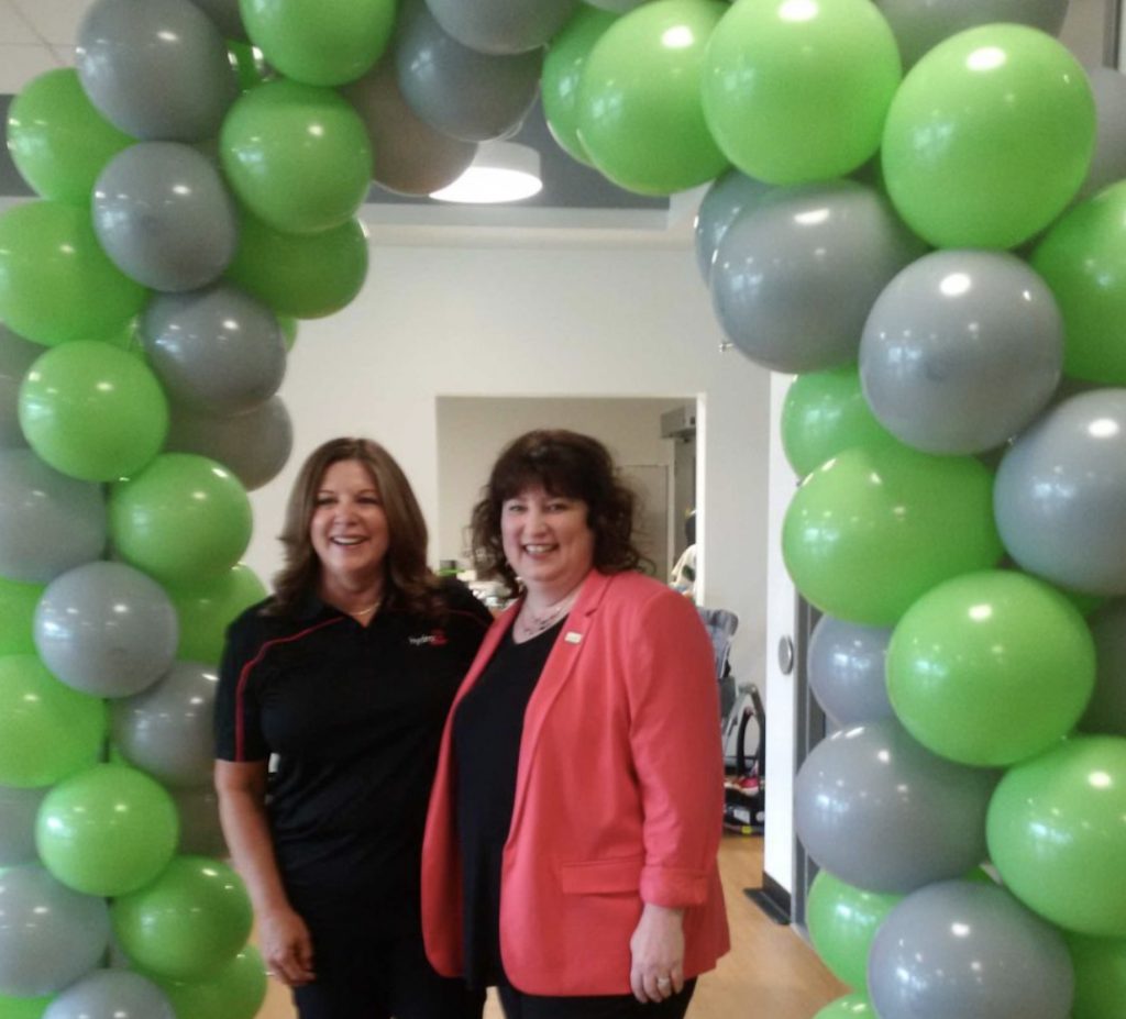 Lisa Williamson and Pamela Fuselli in front of balloons
